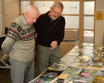 Ken Crawford (left) judges the 2016 Schools Photo Comp with assistance from Laurie Westcott (photo by Graham Brown)