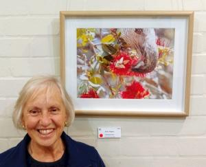 Chris Rogers with her photograph 'Red Wattle Bird', donated by the Friends to the Gardens